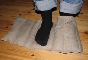 Kanalsydd dyna som kan vikas runt händer eller fötter eller att lägga sig på