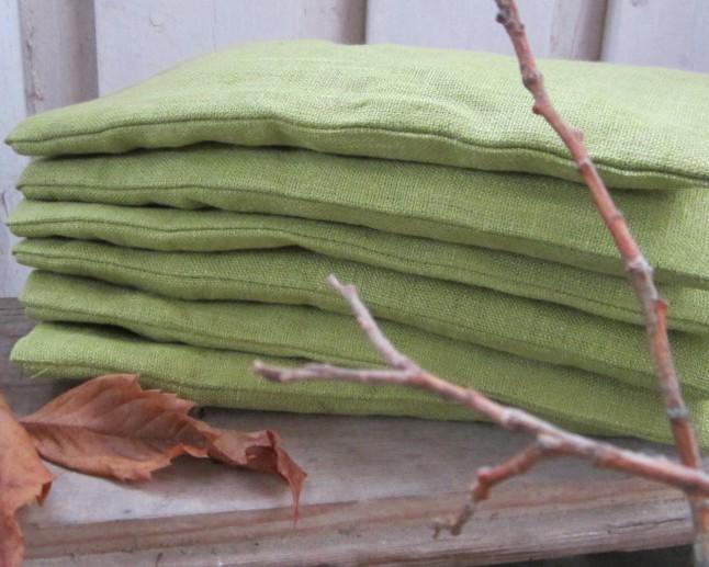 Lyst ögonvetekudde i vårgrönt lin